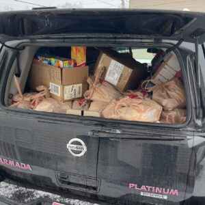 bags of items in trunk of car